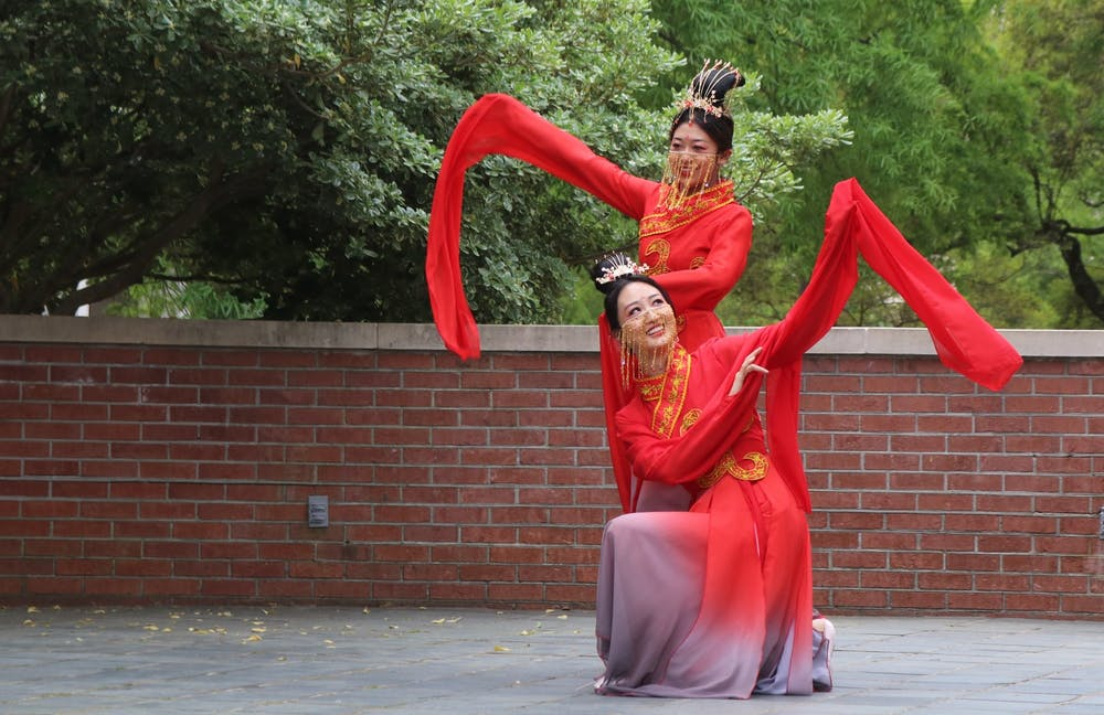 """<p>Students Xingze Zhao and Xinyu Zhang perform """"The left-hand points at the moon,"""" a traditional Chinese dance.</p>"""