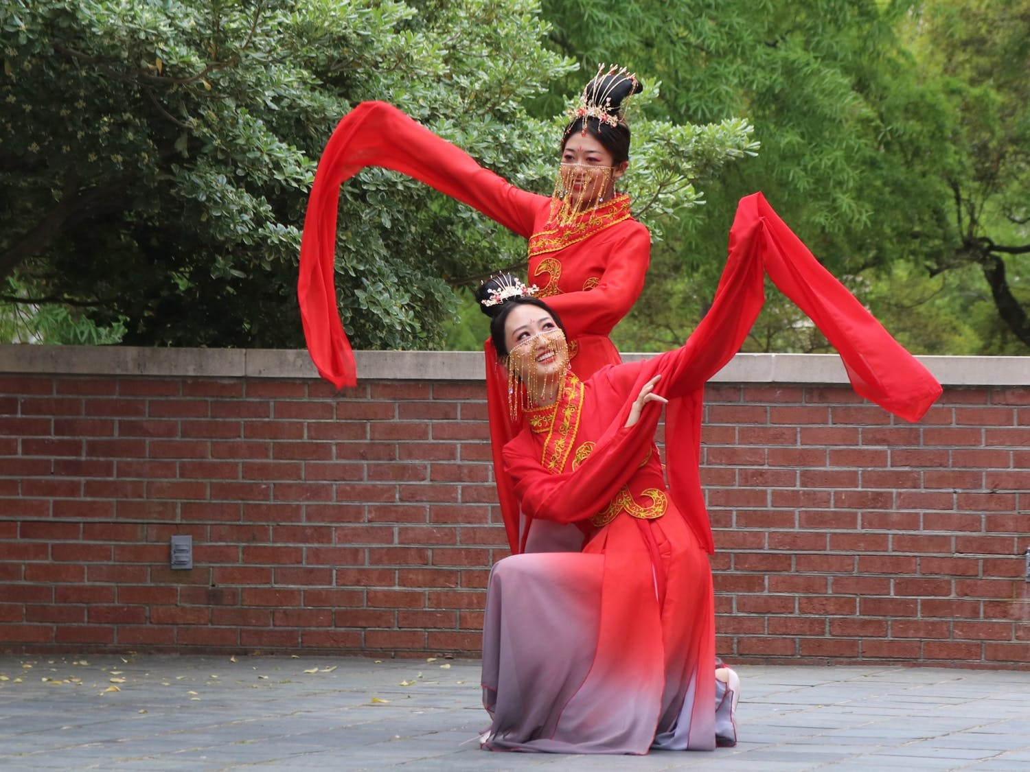 """Students Xingze Zhao and Xinyu Zhang perform """"The left-hand points at the moon,"""" a traditional Chinese dance."""