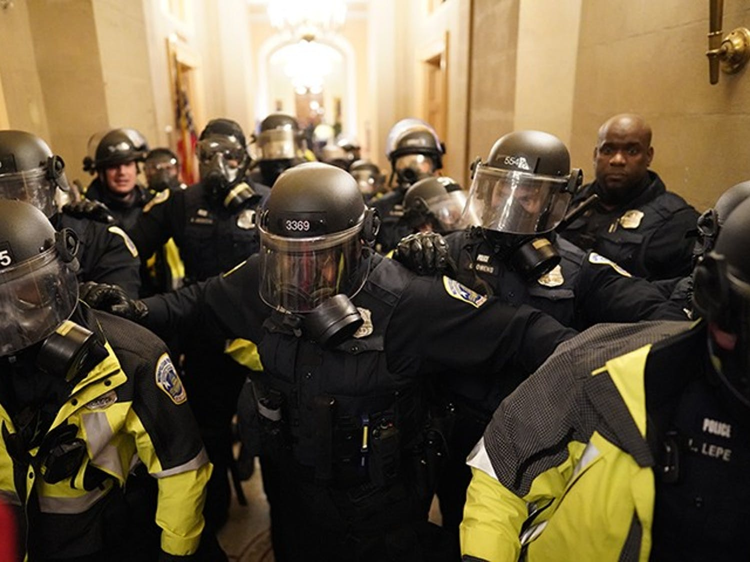 Riot police enter the hallway inside the Capitol building on Jan. 6, 2021.