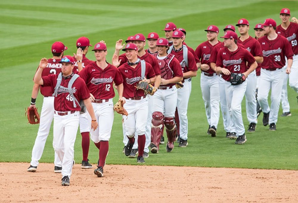 Members of the South Carolina baseball team celebrate Sunday after sweeping No. 5 Florida in a weekend series. The Gamecocks improved to 16-6 on the season following the win.