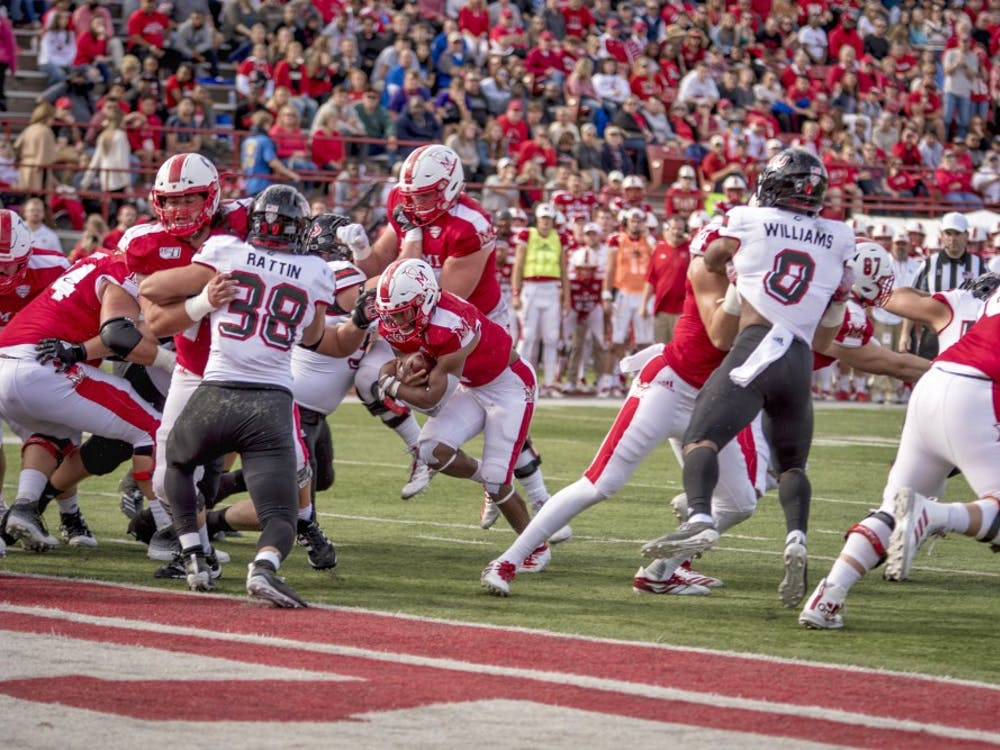 Junior running back Jaylon Bester carries the ball for Miami in a 27-24 RedHawks victory at Yager Stadium on Oct. 19. The Miami Student's Michael Vestey ranks Miami second in the MAC East and Northern Illinois last in the MAC West through this season's first seven games.