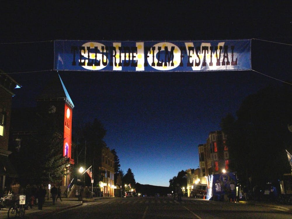 The festival banner hung above the main street at dusk. Theaters up and down the main stretch sometimes played from 8am to past midnight.