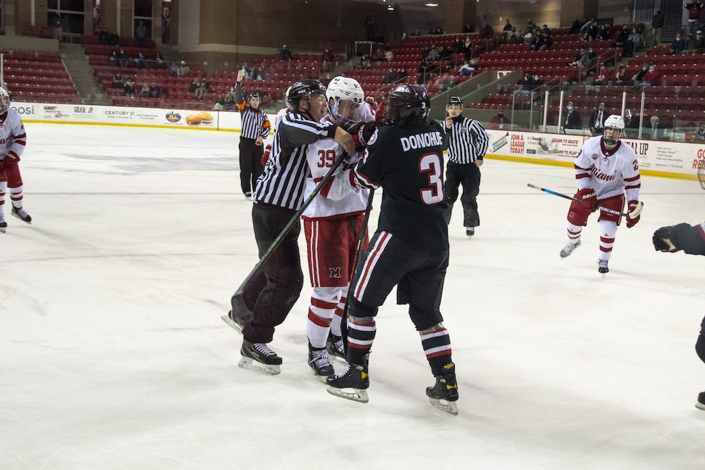 <p>Senior forward Casey Gilling (pictured, middle) had to be restrained during the 3rd period of Friday&#x27;s win over St. Cloud.</p>