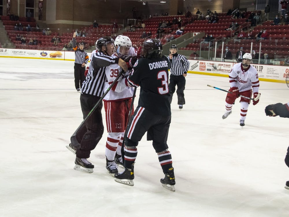 Senior forward Casey Gilling (pictured, middle) had to be restrained during the 3rd period of Friday's win over St. Cloud.