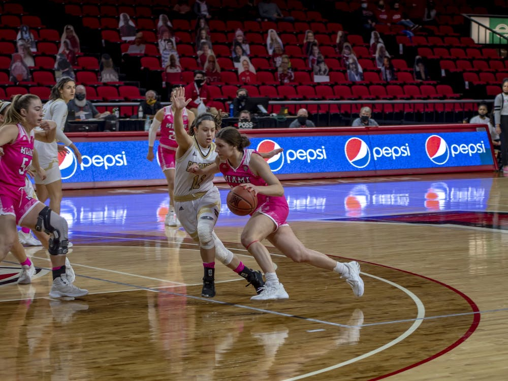 Senior forward Kelly McLaughlin (pictured, left) and freshman guard Katie Davidson (pictured, with ball) had 25 and 21 points, respectively, in last Wednesday's win over Toledo.