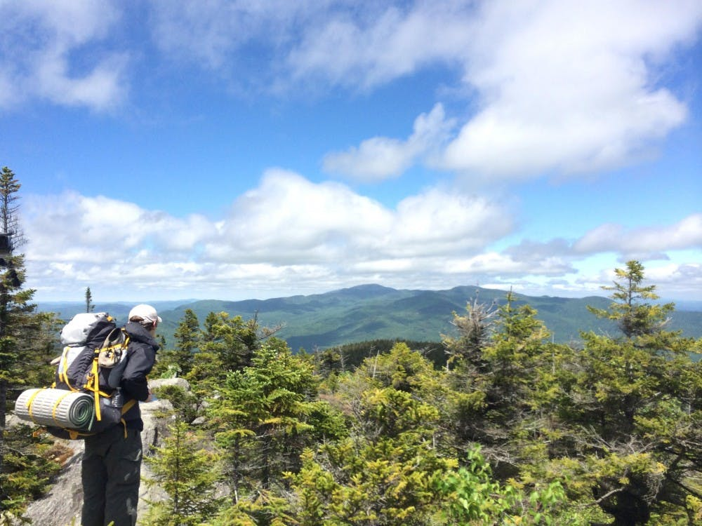 A hiker gazes north toward Mount Mansfield on the Long Trail, a path that traverses Vermont from North to South.