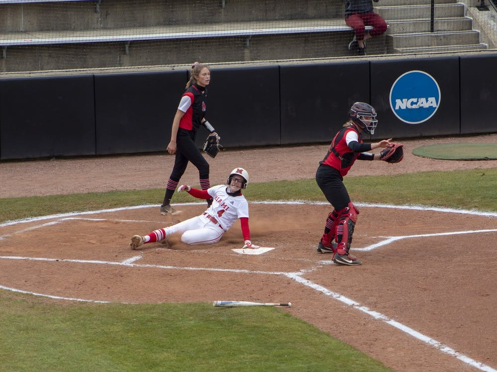 Senior infielder Mackenzie Moore slides into home plate during an April 20 doubleheader vs. Ball State.