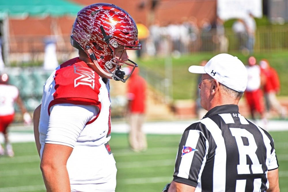 Freshman quarterback Billy Bahl chats with a referee before the OU game.