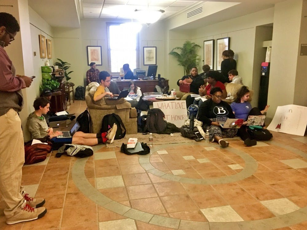 Black students and allies stage a sit-in at Roudebush Hall.