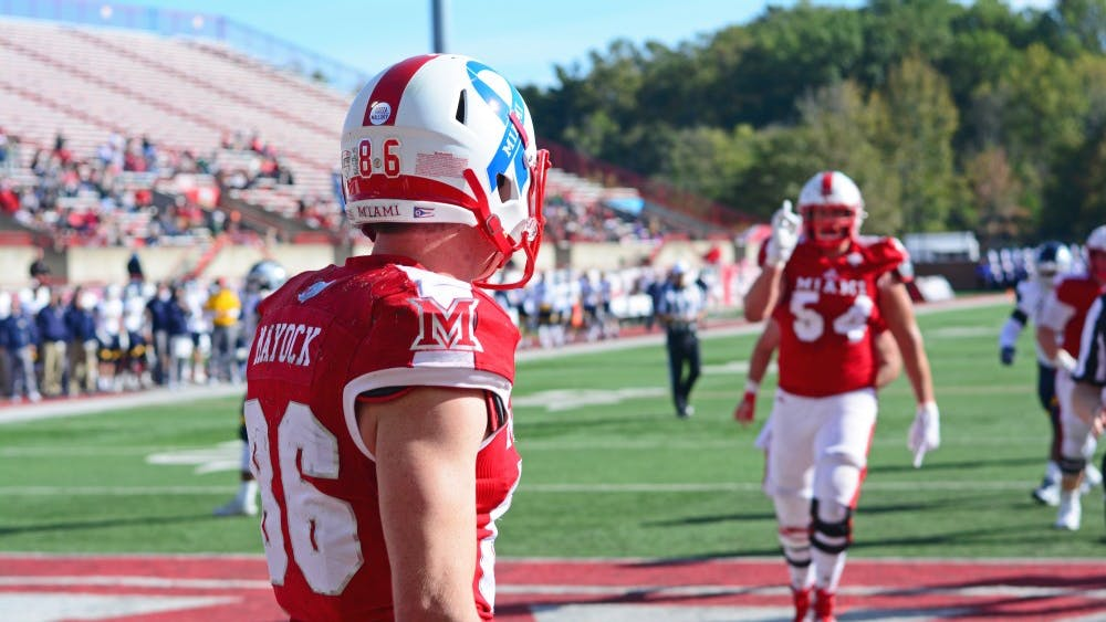 """Redshirt senior wide receiver Luke Mayock donned a blue ribbon last season. This year's version of the helmets features the Miami """"M"""" instead of the school name."""