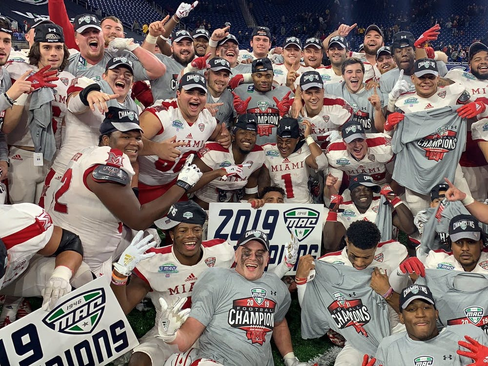 The Miami RedHawks hold up their Mid-American Conference Champions shirts during the postgame celebration Saturday at Ford Field.