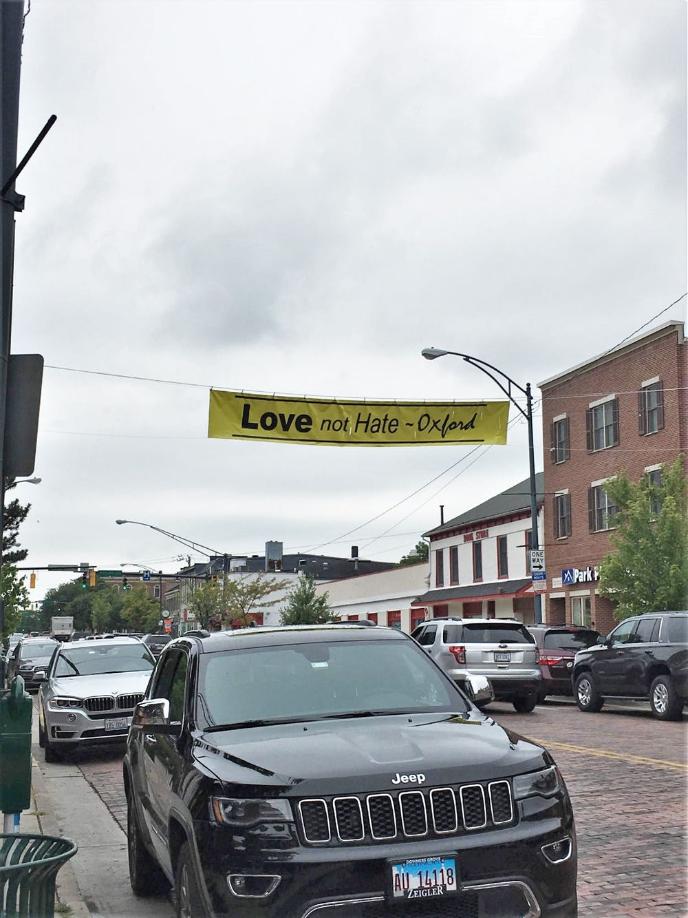 <p>&quot;Defending Democracy&quot; hung a banner Uptown after the recent anti-Asian violence.</p>