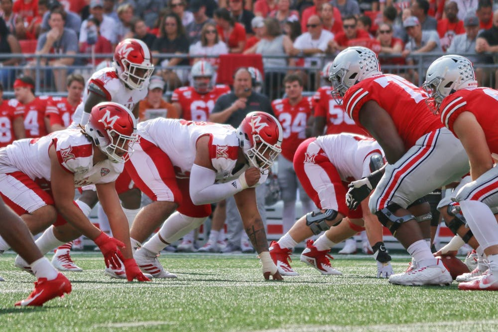 <p>Senior defensive lineman Doug Costin (middle) lines up against Ohio State during a 76-5 Miami loss Sept. 21 at Ohio Stadium.</p>