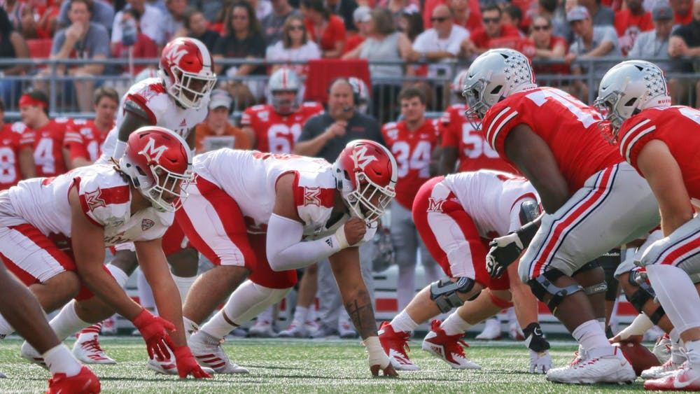 Senior defensive lineman Doug Costin (middle) lines up against Ohio State during a 76-5 Miami loss Sept. 21 at Ohio Stadium.