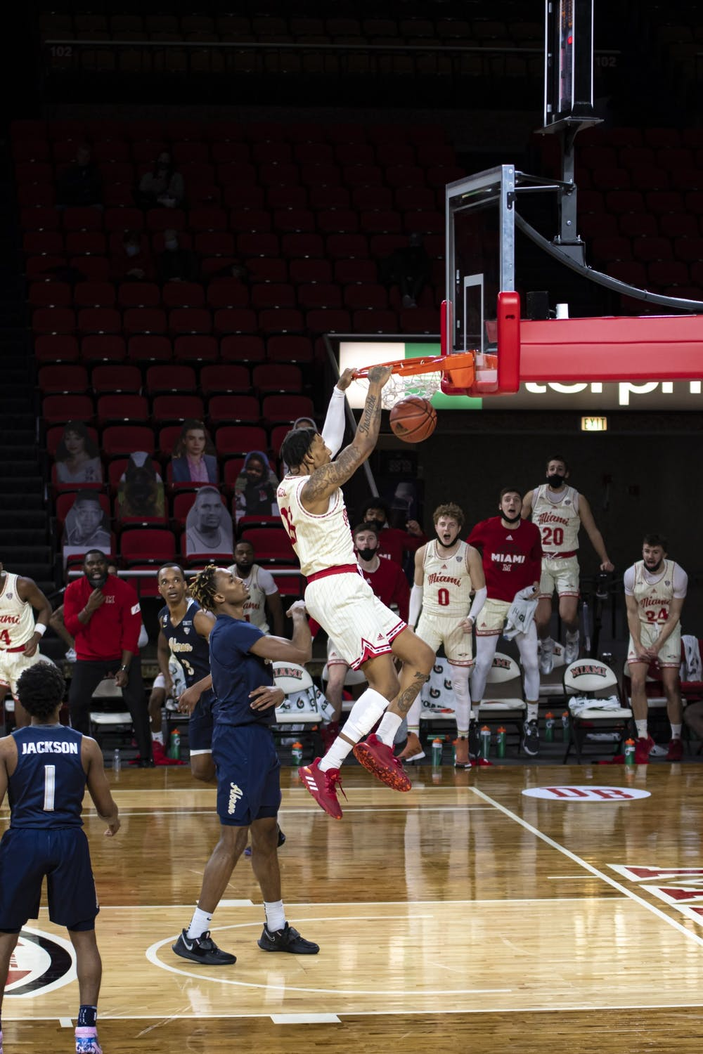 <p>Redshirt junior forward James Beck dunks the ball during a loss against Akron on Feb 12.</p>