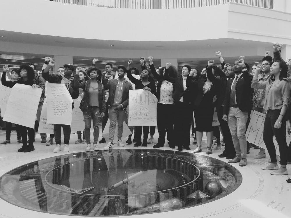 Student activists stand in solidarity by the Seal after BAM 2.0 leadership met with administrators.