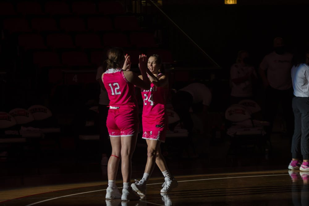 <p>Sophomore guard Peyton Scott (pictured, right) made a 3-point buzzer beater to beat Kent State, 61-58.</p>