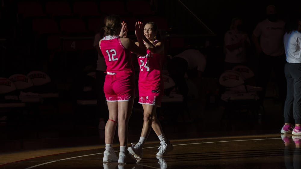 Sophomore guard Peyton Scott (pictured, right) made a 3-point buzzer beater to beat Kent State, 61-58.