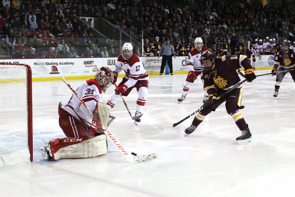 <p>Miami senior goaltender Ryan Larkin makes a save during a Nov. 15-16 series against Minnesota Duluth at the Steve &#x27;Coach&#x27; Cady Arena. The RedHawks split the series, winning Friday night before losing Saturday.</p>