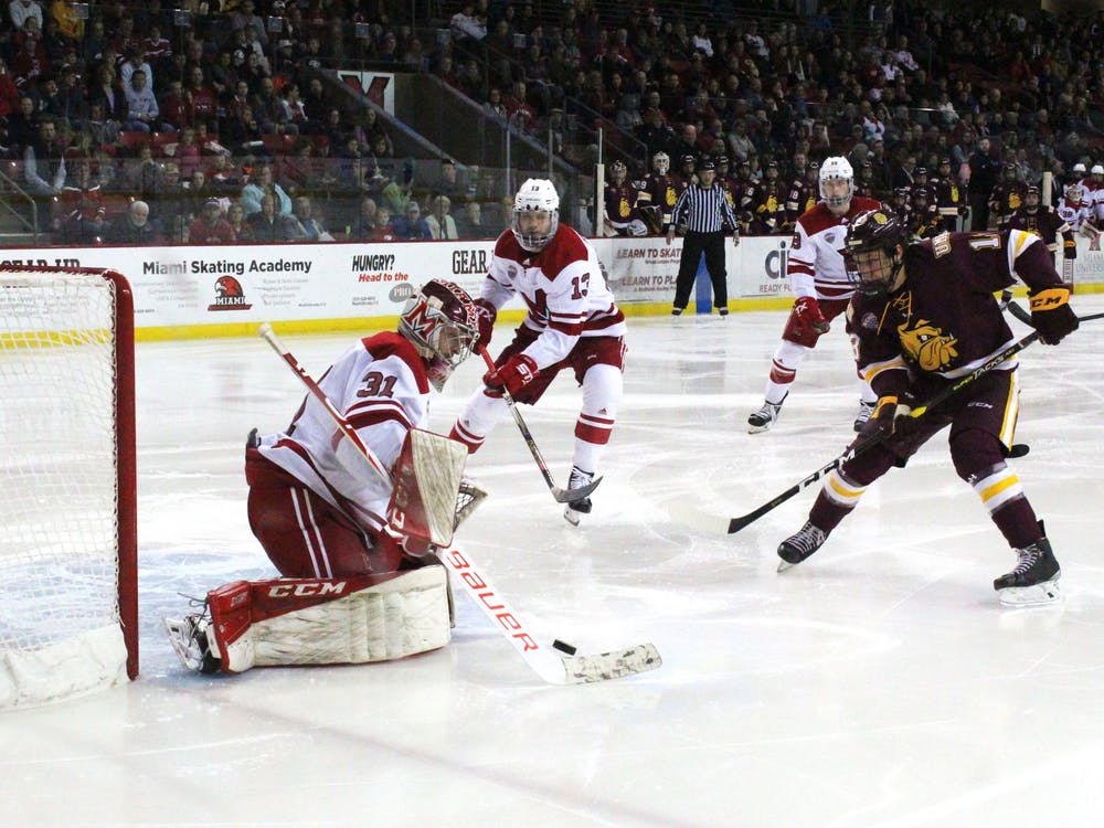 Miami senior goaltender Ryan Larkin makes a save during a Nov. 15-16 series against Minnesota Duluth at the Steve 'Coach' Cady Arena. The RedHawks split the series, winning Friday night before losing Saturday.