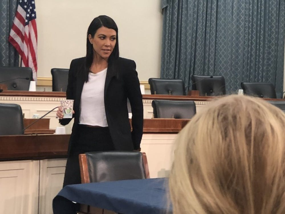 Kourtney Kardashian attends a briefing on Capitol Hall.