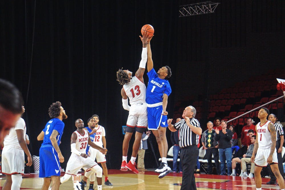 <p>Dalonte Brown attempts to win a tipoff against Buffalo&#x27;s Montrell McRae on March 1 at Millett Hall.</p>