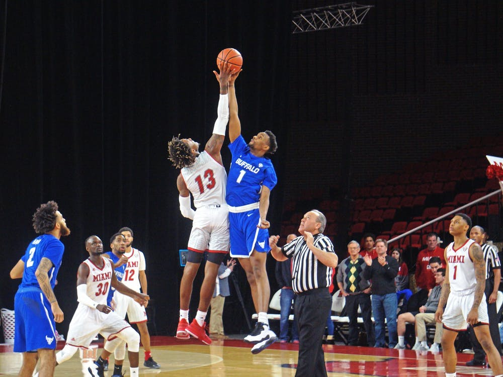 Dalonte Brown attempts to win a tipoff against Buffalo's Montrell McRae on March 1 at Millett Hall.