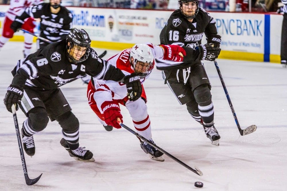 Junior defenseman Colin Sullivan fights for the puck against Providence.