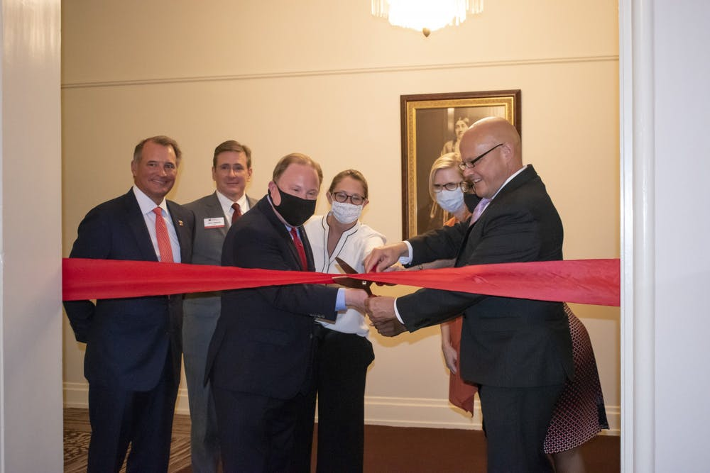 <p>Miami University President Greg Crawford helps cut the ceremonial ribbon inside Peabody Hall on Thursday, Aug. 26, symbolizing the beginning of Miami&#x27;s new Honors College.</p>