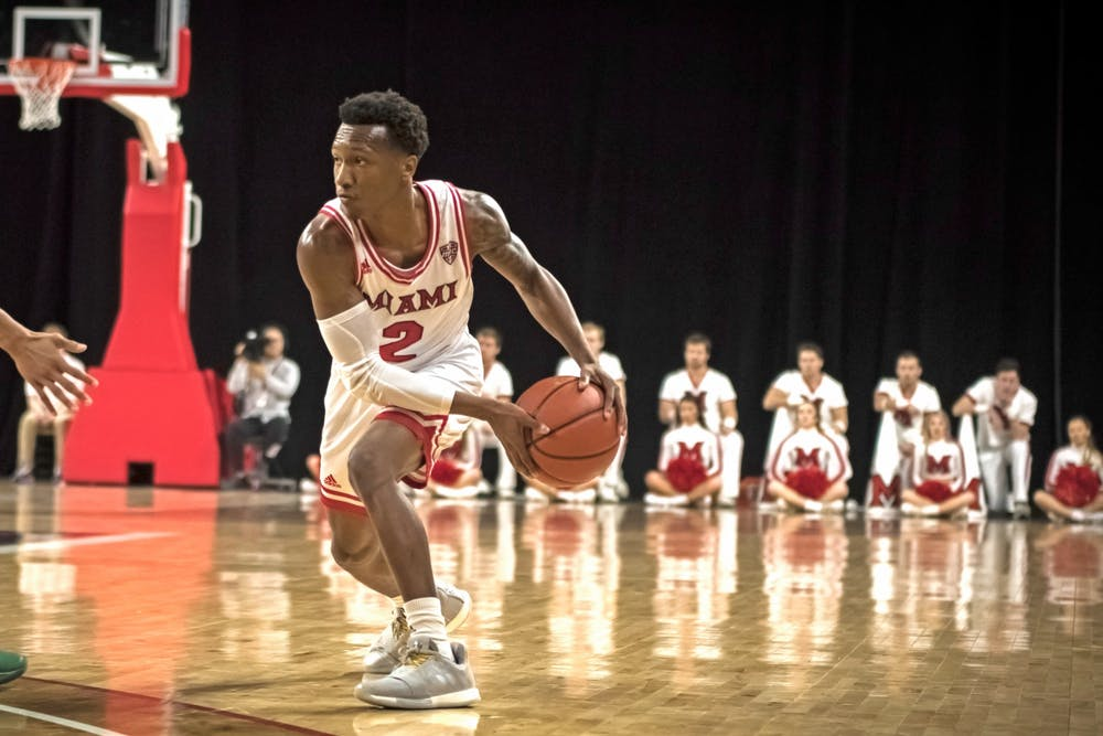 <p>Sophomore guard Mekhi Lairy passes the ball against Central State during an 80-45 Miami victory on Nov. 20 at Millett Hall.</p>
