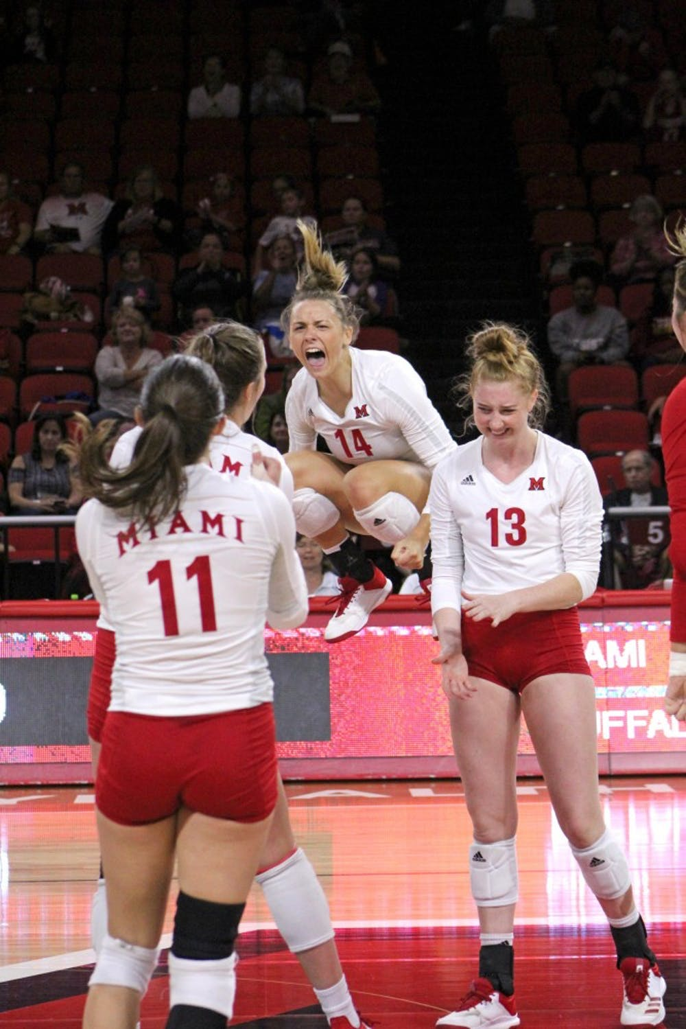<p>Senior right side Sarah Wojick (pictured, middle) led the team with 25 total kills in Miami&#x27;s series vs. Bowling Green.</p>