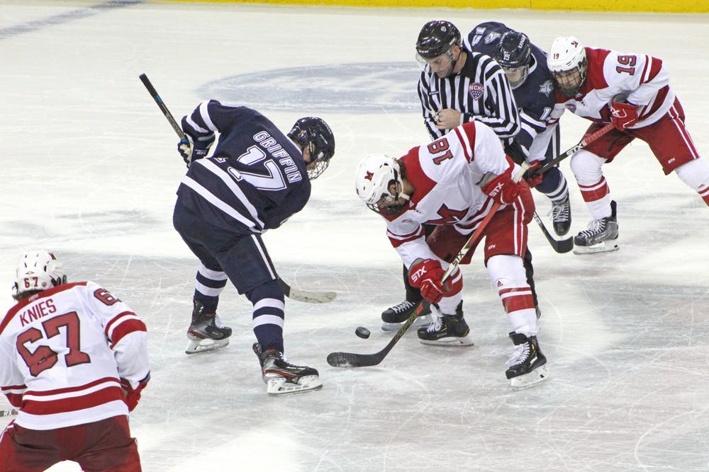 <p>Sophomore forward Monte Graham battles for the puck during a 4-4 tie against New Hampshire on Oct. 12 at the Goggin Ice Center.</p>