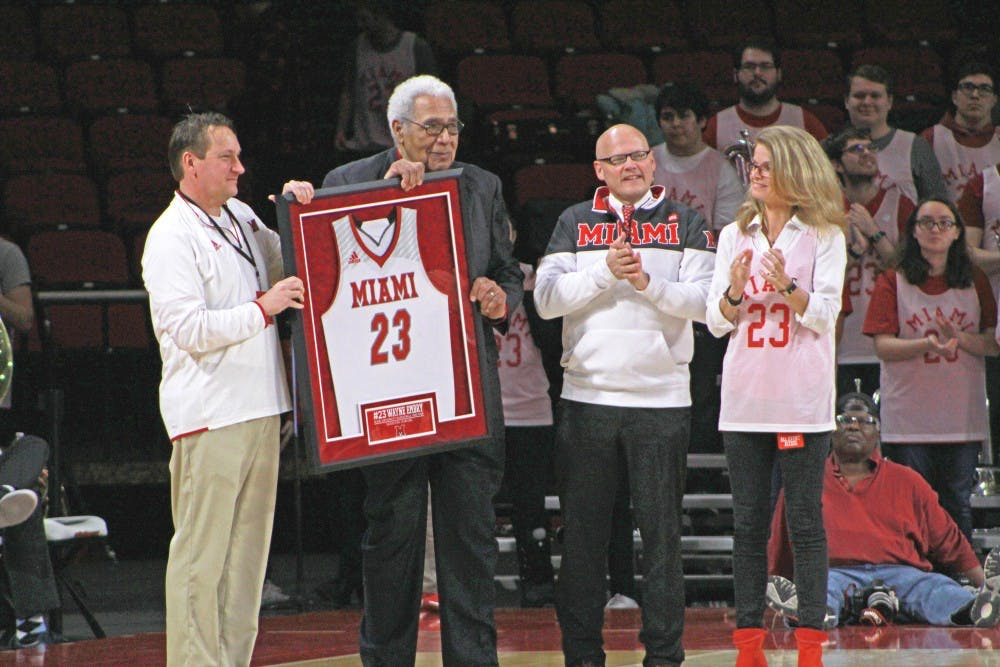 <p>Wayne Embry (second from left) receives a framed jersey on &quot;Wayne Embry Day,&quot; Feb. 10, 2019, at Millett Hall.</p>