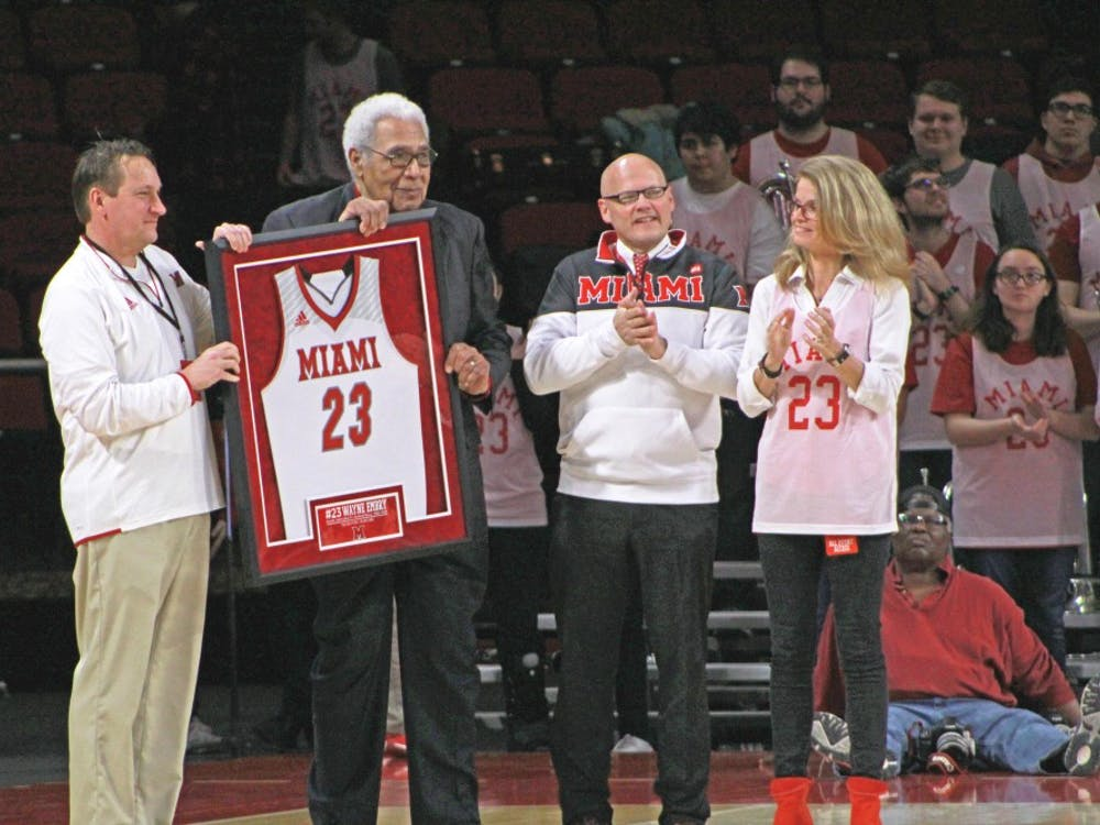 "Wayne Embry (second from left) receives a framed jersey on ""Wayne Embry Day,"" Feb. 10, 2019, at Millett Hall."