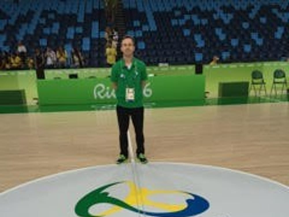 Chris Leazier, a Miami grad and the assistant coach of the Nigerian Olympic basketball team, stands on the court in Rio.