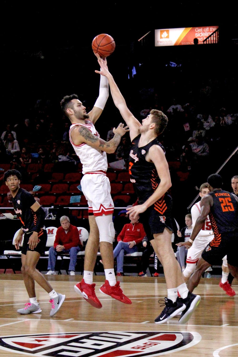 <p>Miami sophomore forward Eli McNamara attempts a hook shot over a Bowling Green defender during a 73-55 RedHawk victory over the Falcons on Feb. 29 at Millett Hall.</p>