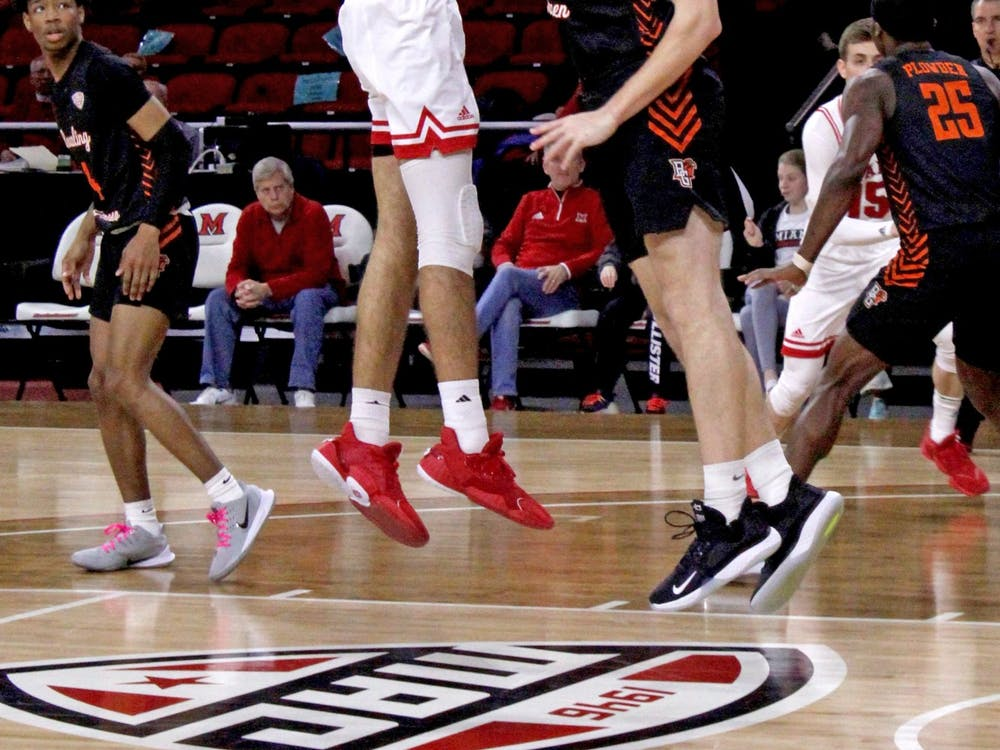 Miami sophomore forward Eli McNamara attempts a hook shot over a Bowling Green defender during a 73-55 RedHawk victory over the Falcons on Feb. 29 at Millett Hall.