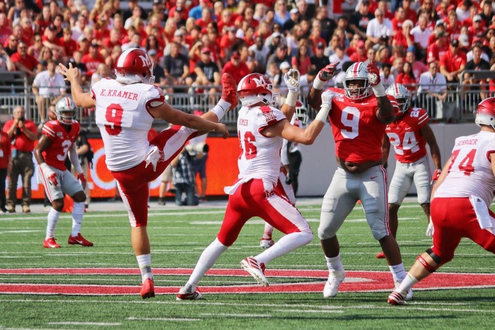 <p>Redshirt senior punter Kyle Kramer punts the ball away during Miami&#x27;s 76-5 loss to Ohio State Sept. 21, 2019, at Ohio Stadium.</p>
