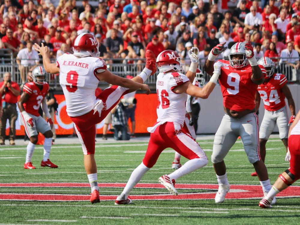 Redshirt senior punter Kyle Kramer punts the ball away during Miami's 76-5 loss to Ohio State Sept. 21, 2019, at Ohio Stadium.