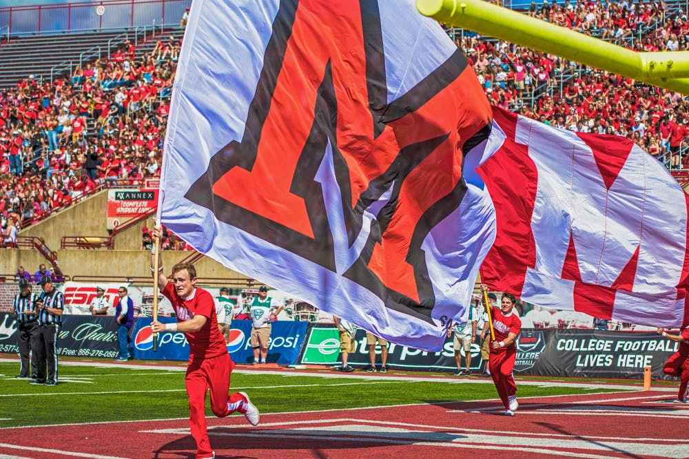<p>Dane Doebereiner runs across the Yager Stadium end zone with a white Miami flag. The scamper around the field is the Miami cheerleaders customary celebration when the football RedHawks score a touchdown.</p>