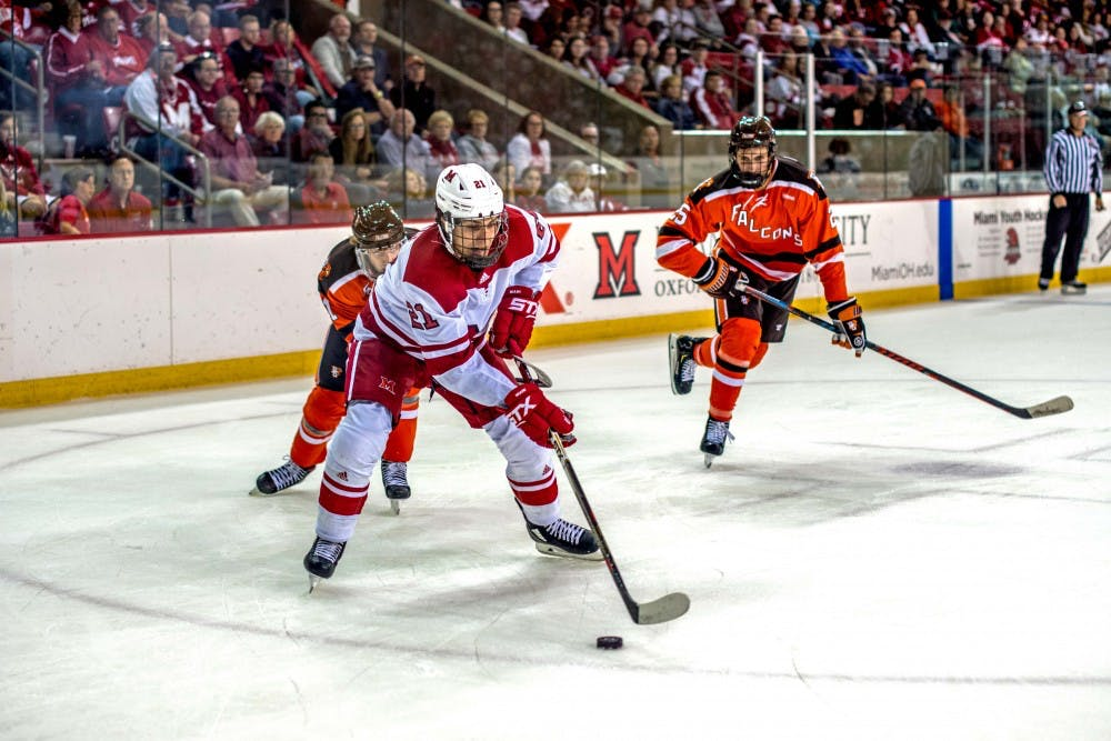 <p>In his first collegiate game, freshman forward Ryan Savage handles the puck as two falcons bear down on him Sunday. Savage was held without a point, as his team lost 7-4.</p><p><br/><br/><br/><br/><br/><br/></p>