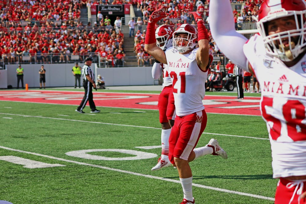 <p>Redshirt sophomore safety Sterling Weatherford and senior defensive lineman Doug Costin celebrate during a 76-5 loss Sept. 21at Ohio Stadium.</p><p><br/><br/><br/><br/><br/><br/></p>