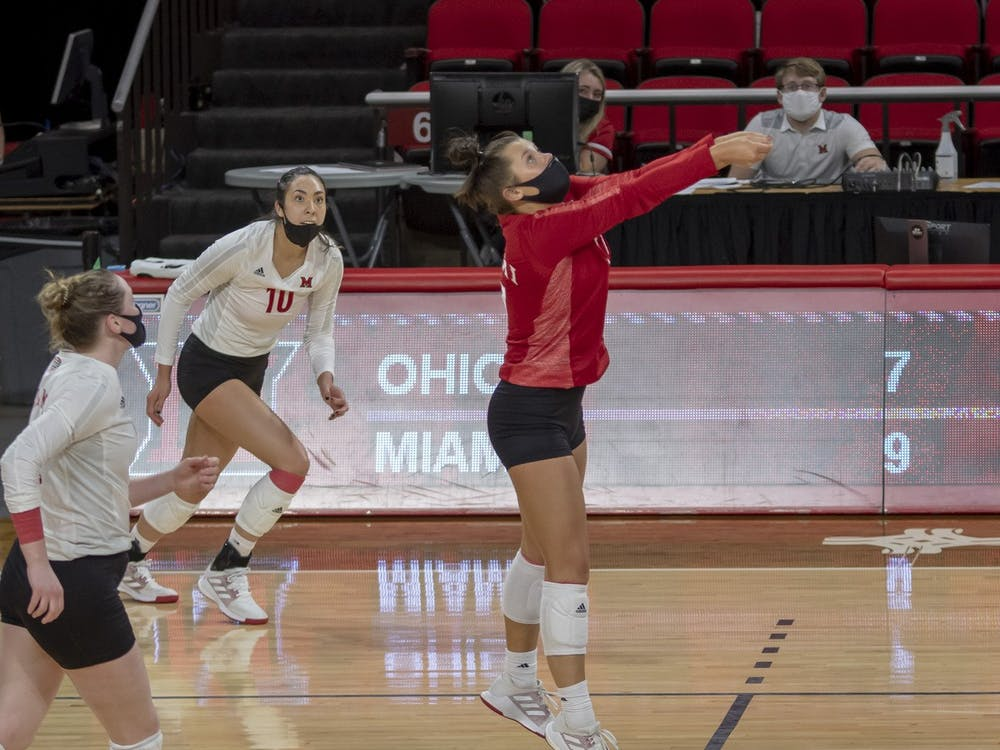 Senior libero Abigail Huser (pictured, in red) executes a bump during a week series vs. Ohio University.