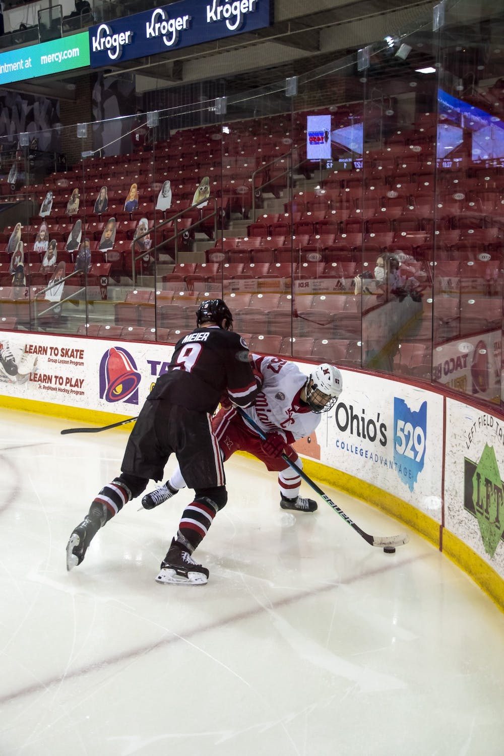 <p>Senior forward Phil Knies attempts to control the puck during a weekend series vs. St Cloud State.</p>