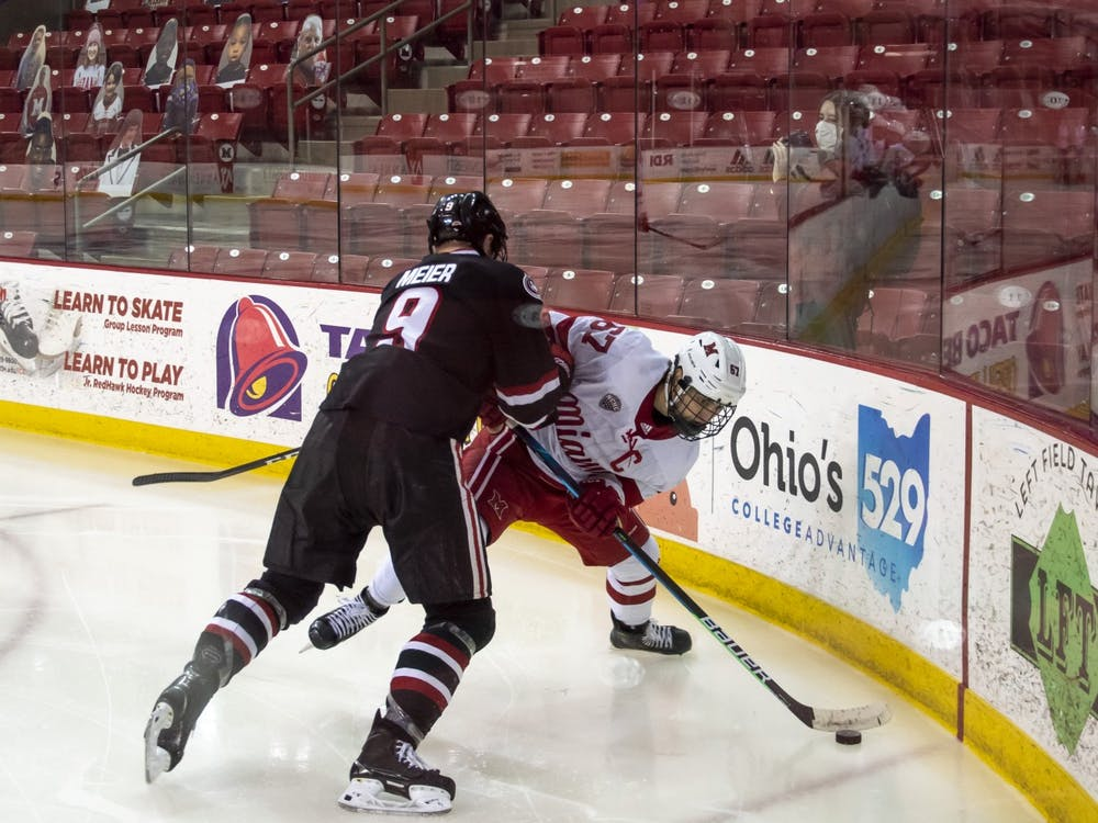 Senior forward Phil Knies attempts to control the puck during a weekend series vs. St Cloud State.