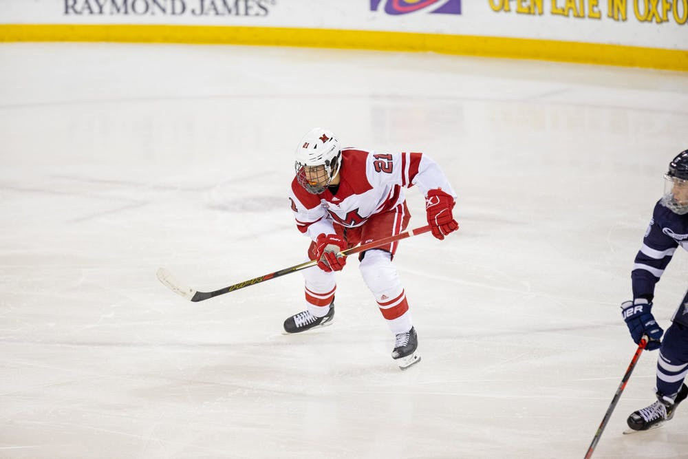 <p>Freshman forward Ryan Larkin skates against New Hampshire on Oct. 12 at the Steve &#x27;Coach&#x27; Cady Arena in the Goggin Ice Center. Miami tied UNH, 4-4, in an overtime contest.</p>
