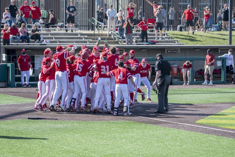 <p>The entire Miami bench mobs outfielder Nate Stone after his walk-off home run Saturday.</p>