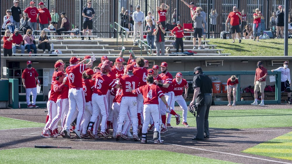 The entire Miami bench mobs outfielder Nate Stone after his walk-off home run Saturday.