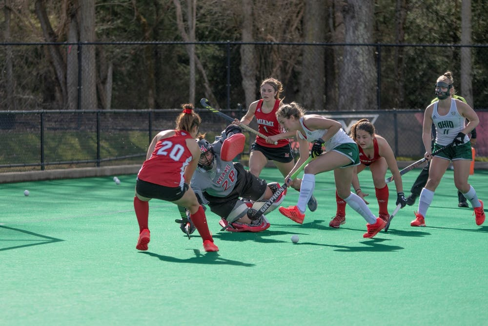 Junior goalkeeper Isabelle Pareese (pictured, No. 28) defends a shot during a Spring 2021 match vs. Ohio University.