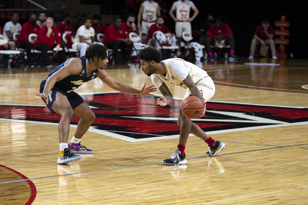 <p>Sophomore guard Dae Dae Grant sizes up a defender during a Feb 12 loss to Akron</p>